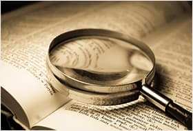 Magnifying glass laying on book