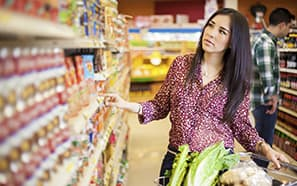 Woman shopping in grocery aisle