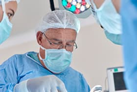 Doctor with mask operating