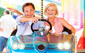 Older couple in bumper car