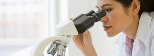 Researcher Looking Through Microscope