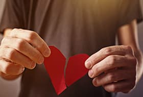 Tearing a paper heart