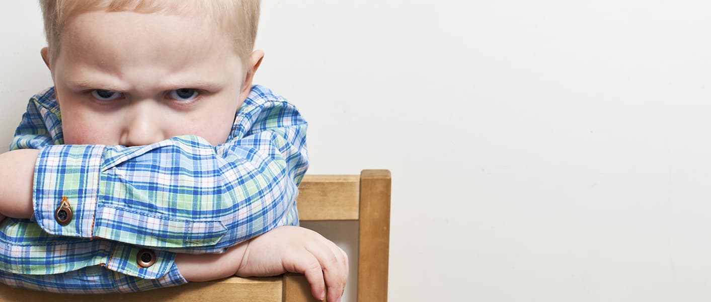 upset child on chair