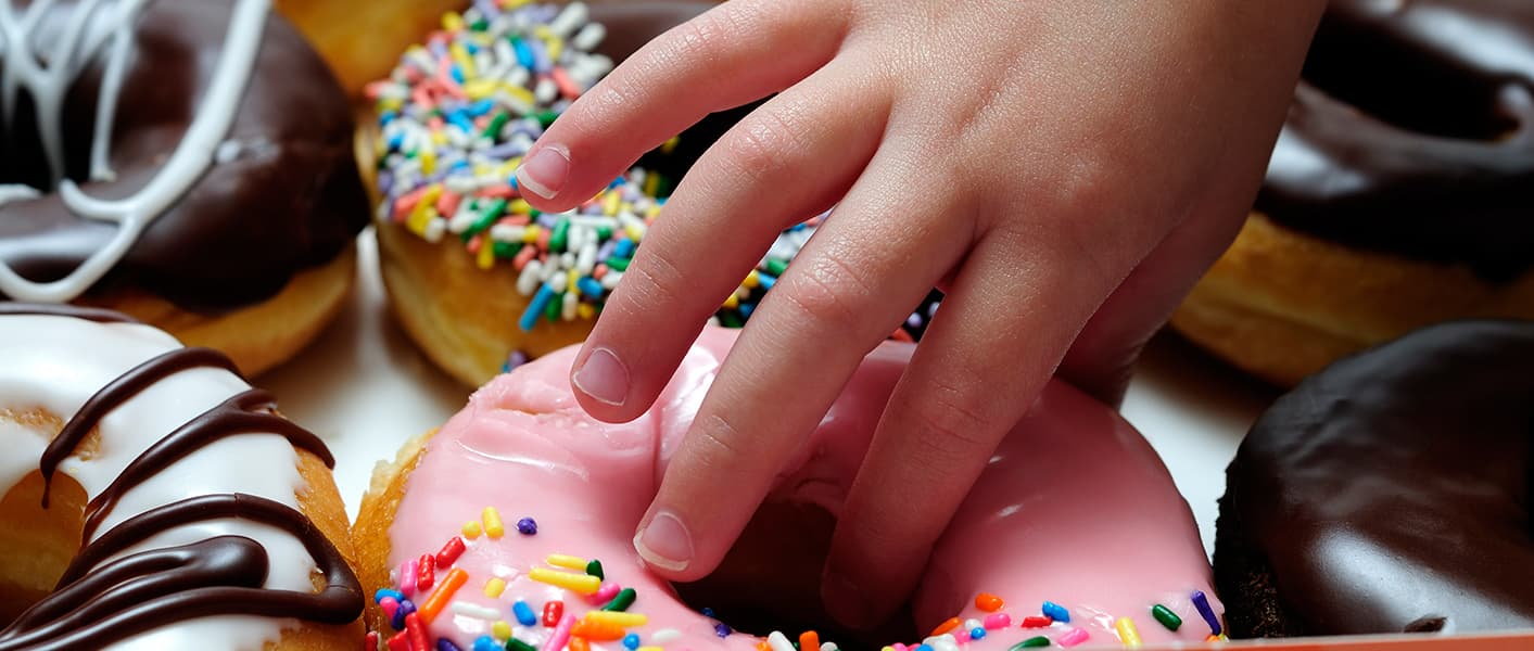 child hand with donut