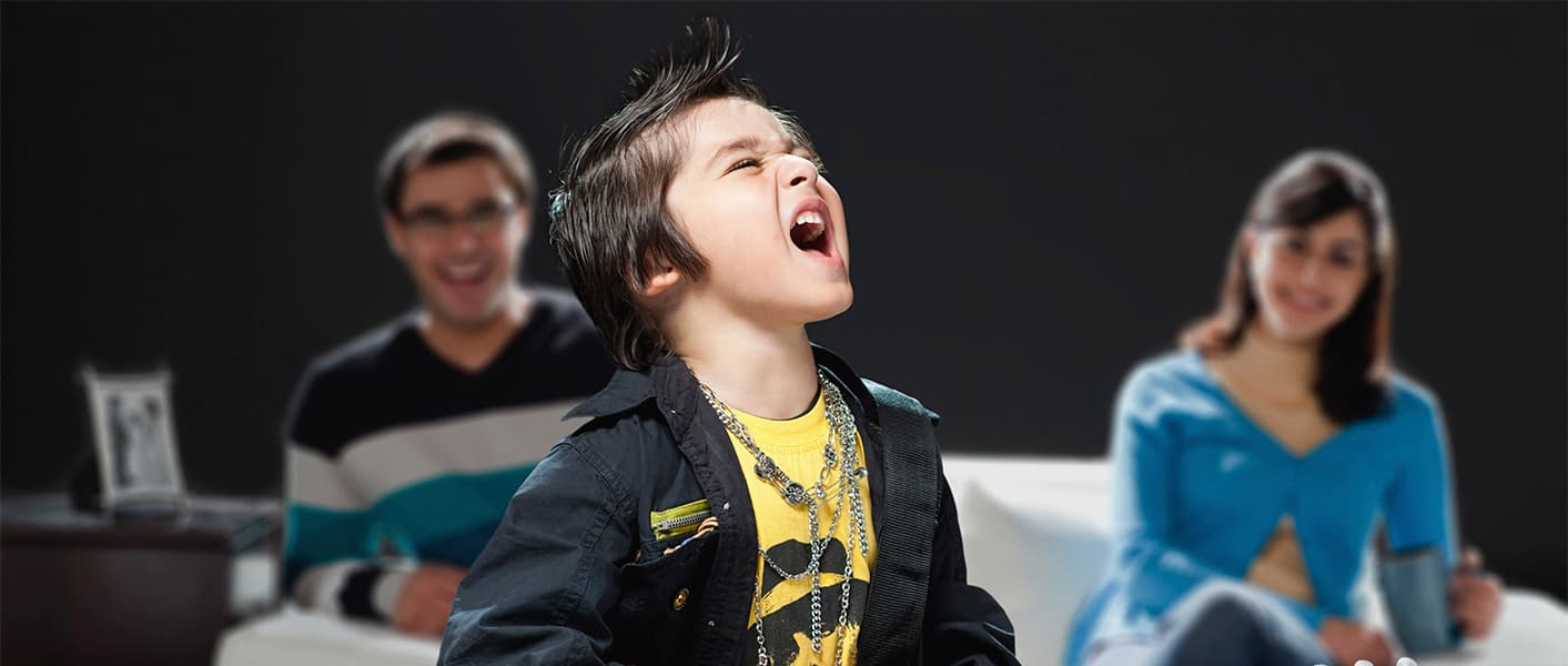 boy singing infront of parents
