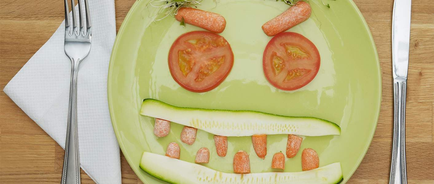 plate of vegetables arranged like a face