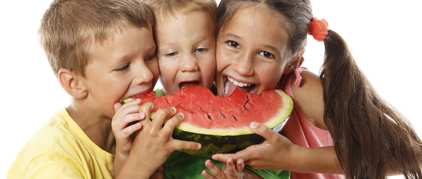 happy kids eating watermelon
