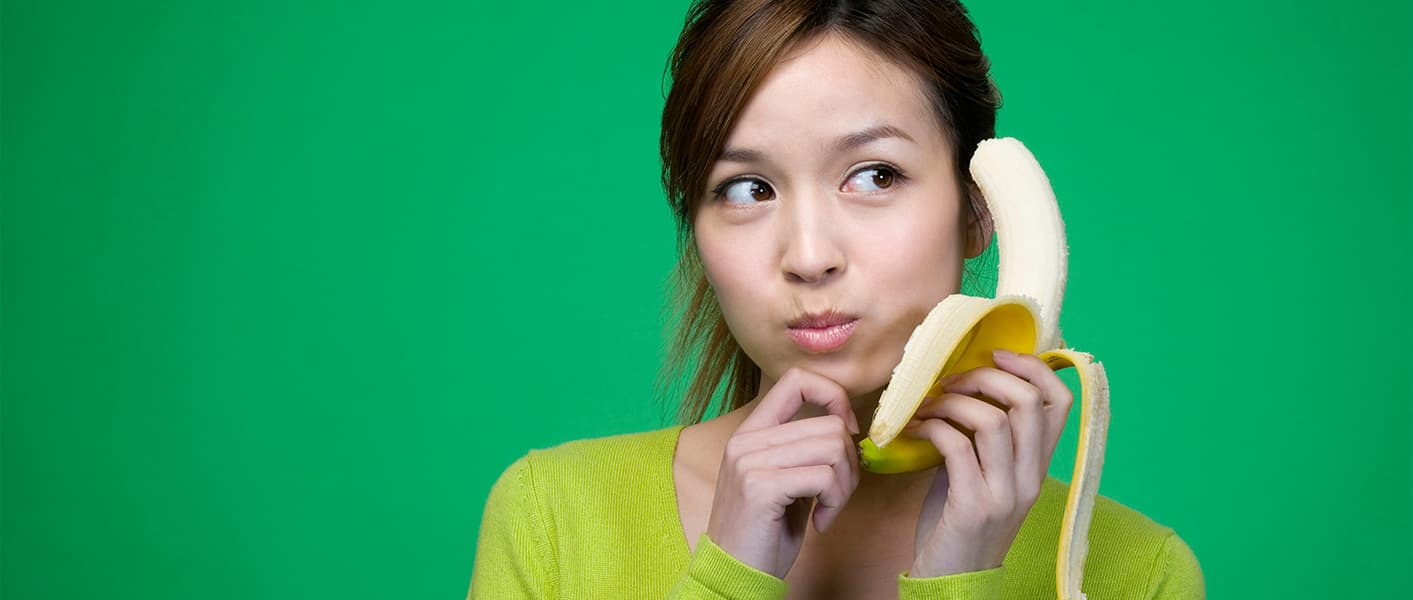 girl holding banana