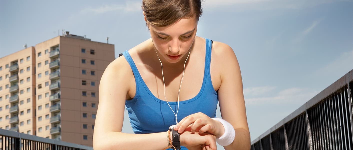 teen working out and checking watch