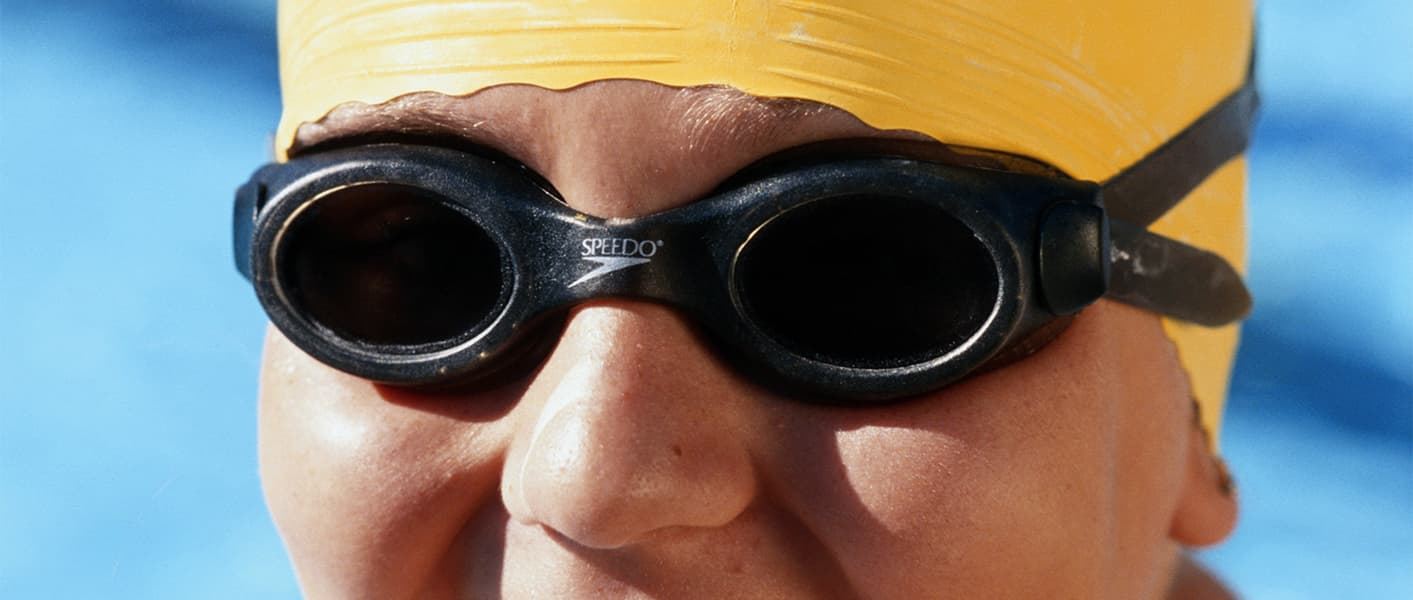 teen wearing swim cap and goggles