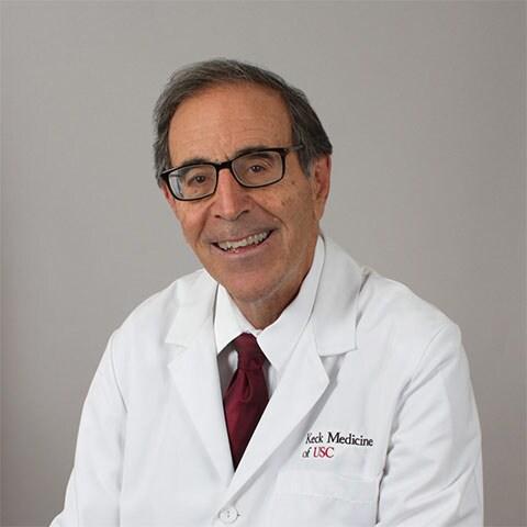 James E. Tibone, MD