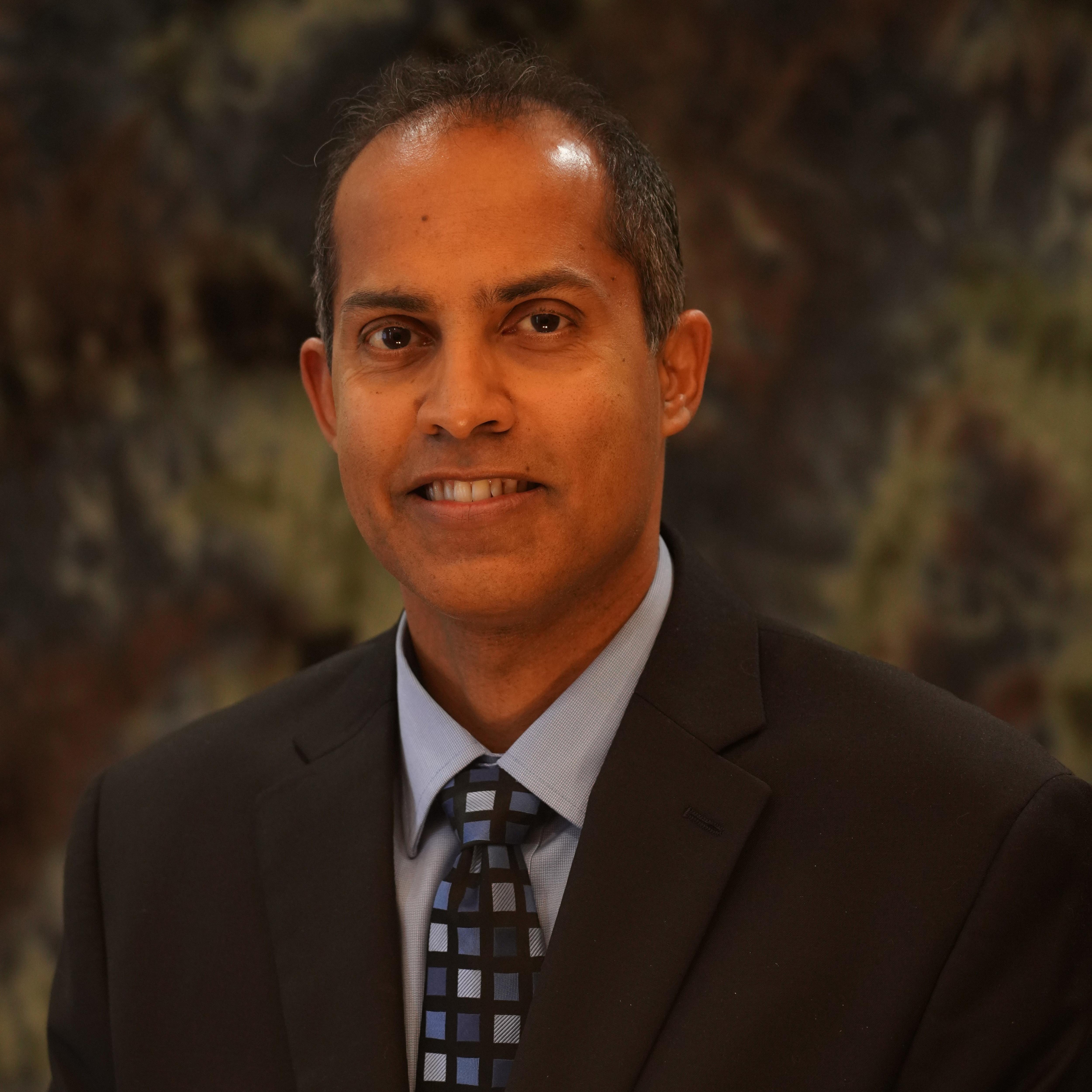 Dr. Dilan Munaweera DDS